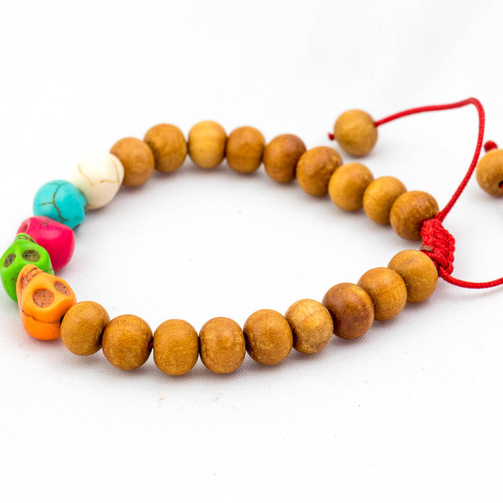Multi Color Skull Wooden Wrist Mala-thamelshop-mens beaded jewelry-tibetan mala shop-tibetan mala bracelets-how to make a wrist mala-wrist beads for guys-wrist mala-bodhi seed wrist mala-impermanence mala-dragons blood mala-japanese wrist mala-mens sandalwood bracelet-adjustable mala beads - hand jewellry- wrist jewellry